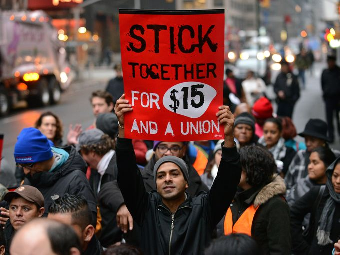 $15/hr protestor in New York City. Peter Foley/EPA
