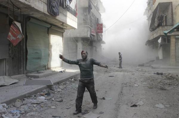Aftermath of a barrel bomb attack, Aleppo, Syria. Credit: Firas Badawi//Reuters