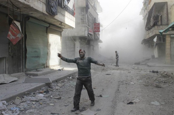 Aftermath of a barrel bomb attack, Aleppo, Syria. Credit: Firas Badawi//Reuters