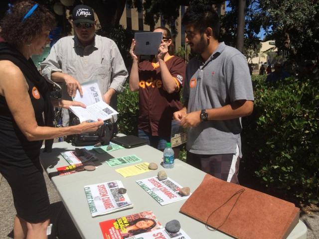 Socialist Alternative talking with the community. Photo by Andrew Mackay