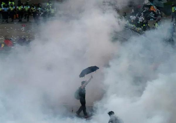 Pro-democracy protestor engulfed by tear gas. Hong Kong, September 28, 2014.