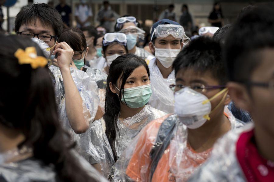 Protestors in anti-pepper spray gear. September 28, 2014. Alex Ogle/AFP