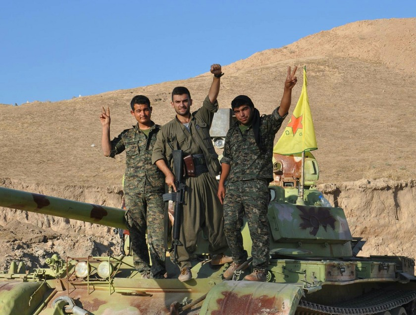 Three PKK fighters pose with an captured ISIS tank.  Taken August 25, 2014.