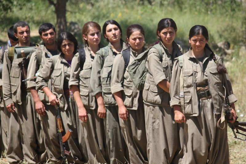Female and male PKK fighters pose during training.