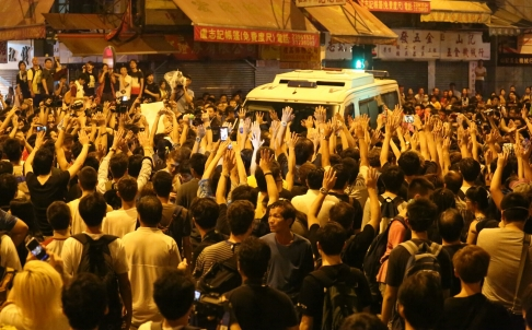 Hong Kong occupiers stop a police vehicle. By Felix Wong.