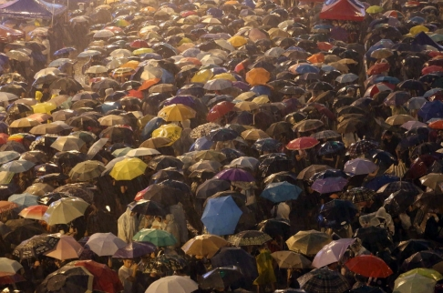A torrential downpour on the mass crowds blocking key parts of Hong Kong