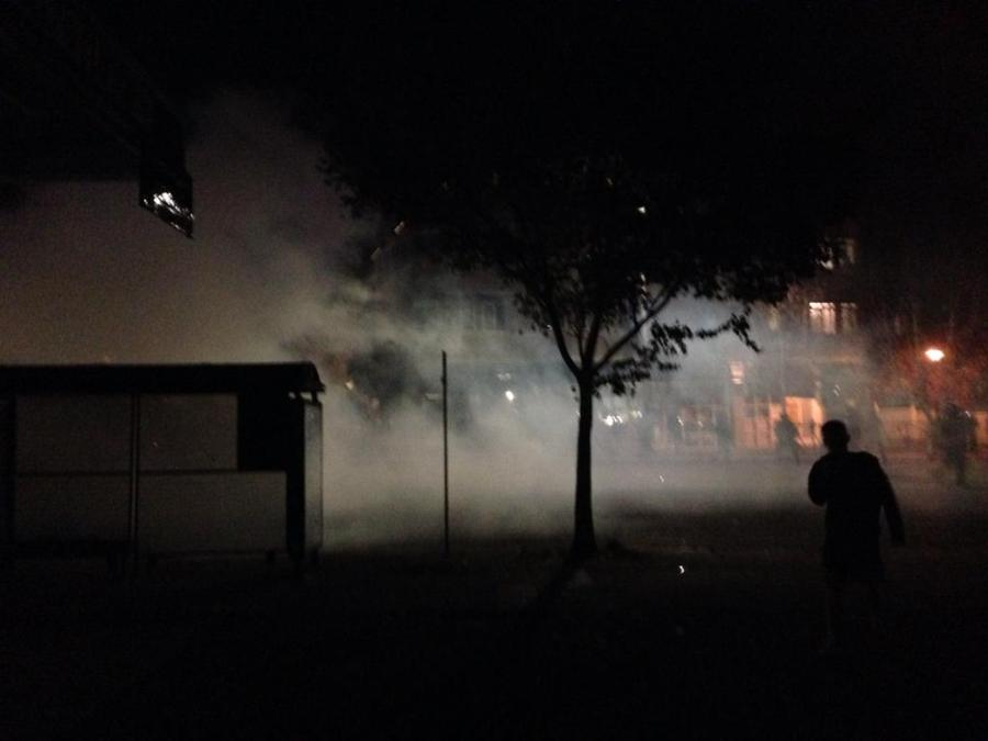 South Telegraph Avenue in Berkeley, CA filled with smoke after police clashes with protestors.