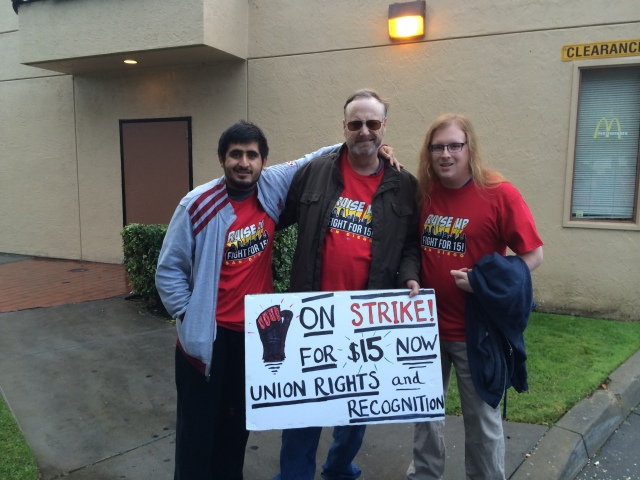 Three members of Socialist Alternative at the December 4, 2014 protest for $15/hr minimum wage. UnspokenPolitics author is on right.