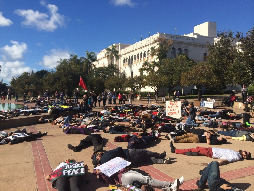 Protestors stage a die-in in Balboa Park, San Diego. December 13, 2014. Photo by Andrew Mackay