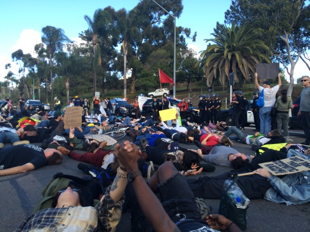 A die-in before an on-ramp to I-5. December 13, 2014. Photo by Andrew Mackay