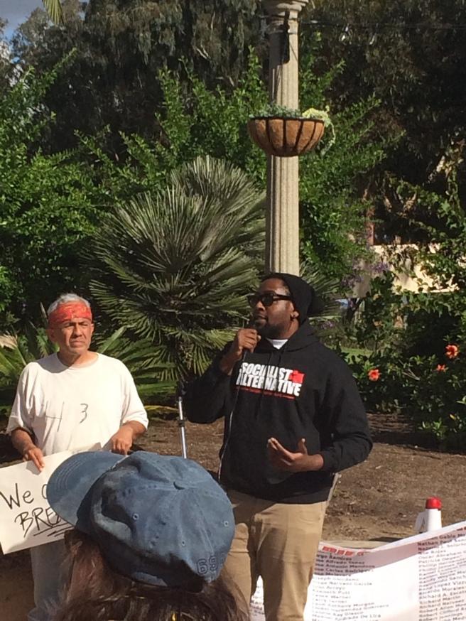 Stephane speaks to the rally in Balboa Park. December 13, 2014. Taken by Andrew Mackay