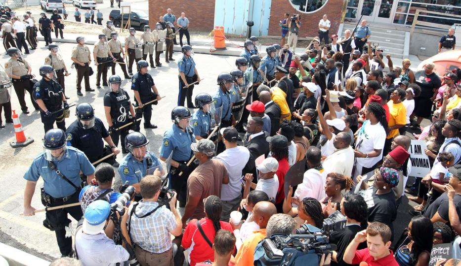 Standoff between protesters and armed police in Ferguson, Missouri. 2014.