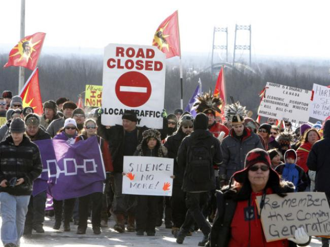 Idle No More indigenous activists in Canada block a highway.