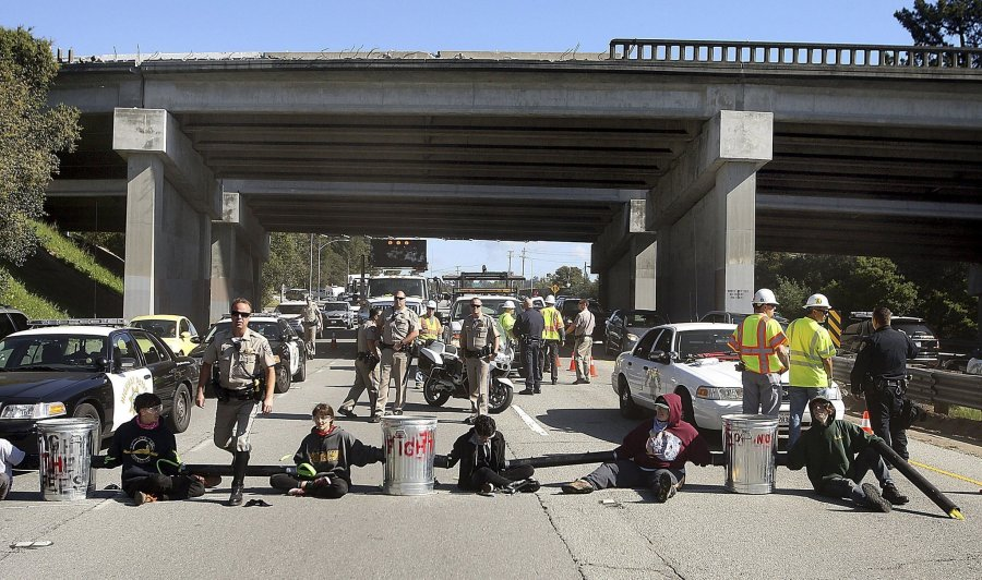 Six students blockade a highway over student fee hikes and police violence against people of color