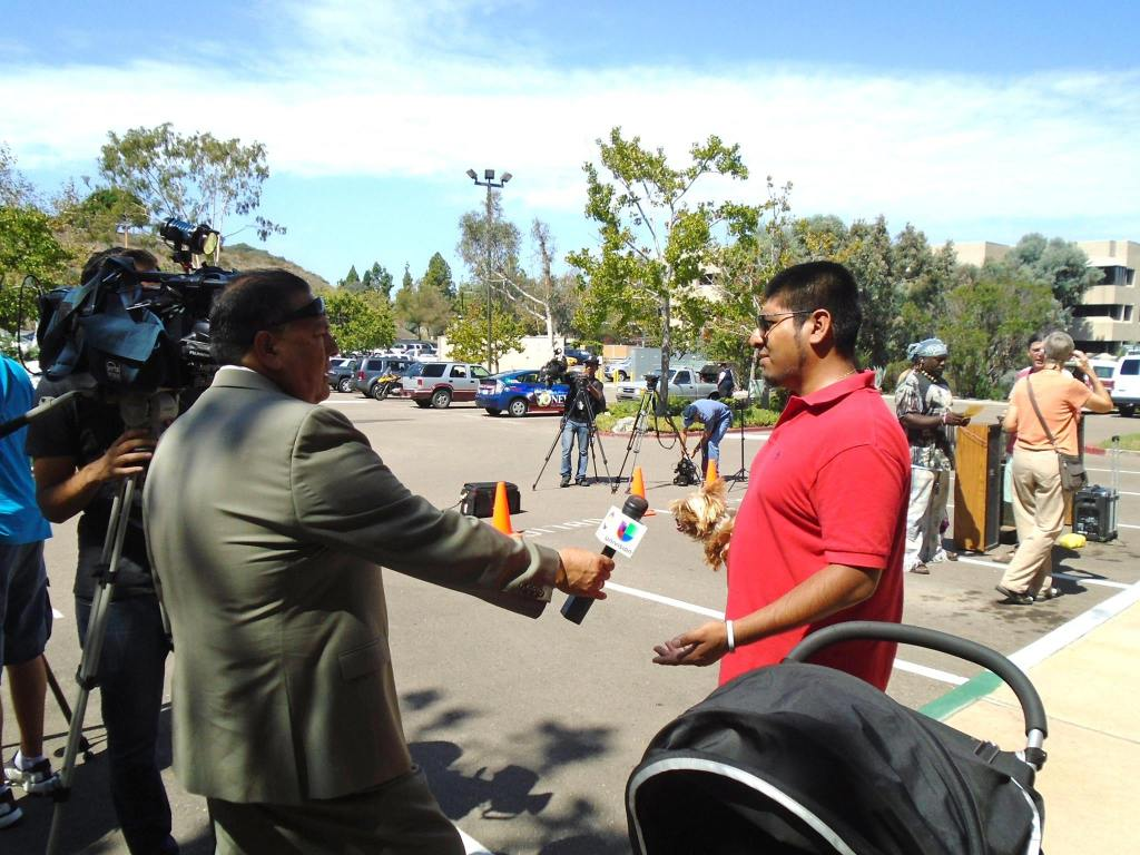 Rafael Bautista speaks to Univision regarding police threats to San Diego activists. Credit- Birdie Gutierrez